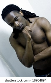 Young Urban African American Male Shirtless with Serious Expression