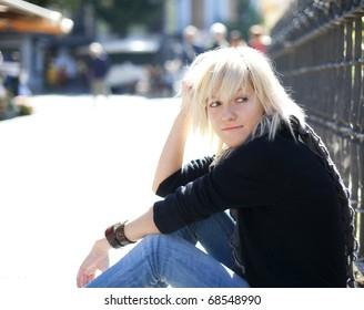 Young urban blond girl staring at something