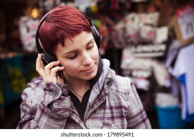 Young urban girl listening to music