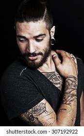 Young urban man with tattoo