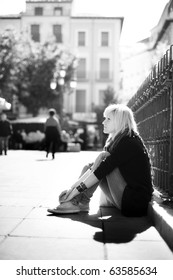 Young urban thougthful blonde  on urban background