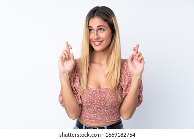 Young Uruguayan woman over isolated white background with fingers crossing
