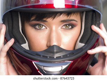 Young Vibrant Intense Girl in Red Full Face Motorcycle Racing Helmet