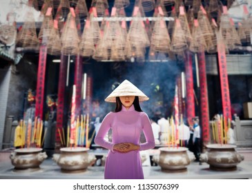 Young Vietnam woman wearing Ao Dai culture traditional at old temple at Ho Chi Minh in Vietnam,vintage style,travel and relaxing concept.