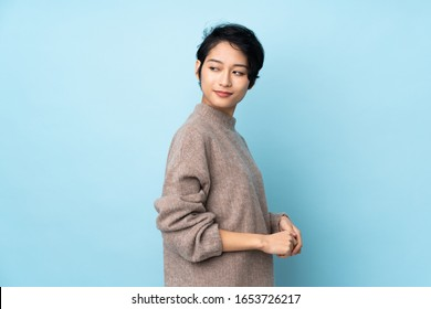 Young Vietnamese woman with short hair over isolated background . Portrait