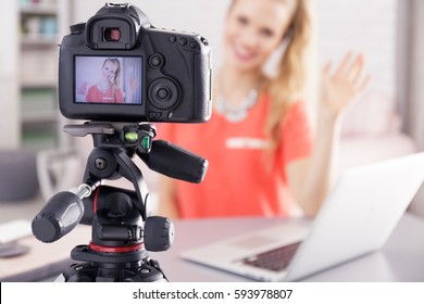 Young vlogger girl recording her new daily videoblog