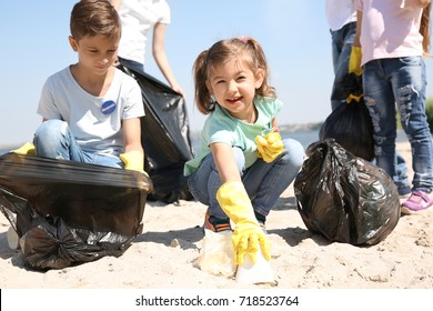 Young volunteers and children collecting garbage on beach