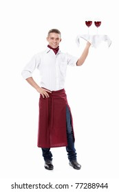 The young waiter with a tray with glasses of wine on a white background