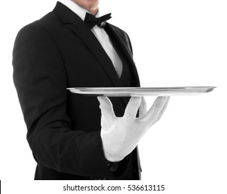 Young waiter with tray on white background