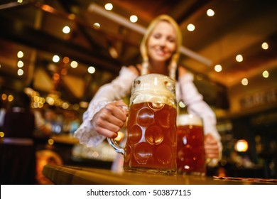 Young waitress in a bar