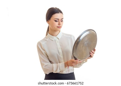 the young waitress holding a large round tray for eating