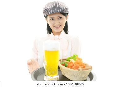 Young waitress serving meals at restaurant.