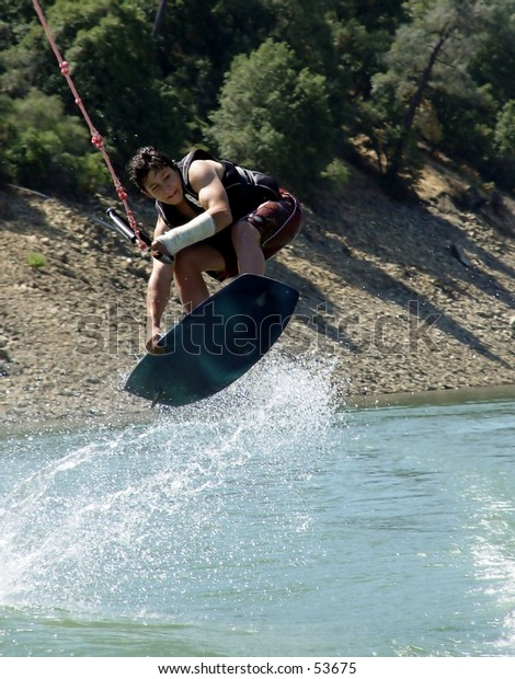Young wakeboarder jumping