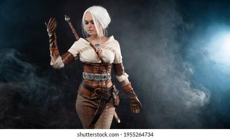A young warrior with a sword on a dark background. Fantasy heroine
