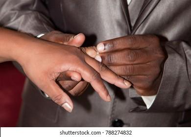 young wedding black american african couple exchange wedding rings