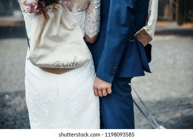 young wedding couple holding hands, groom and bride just happy together
