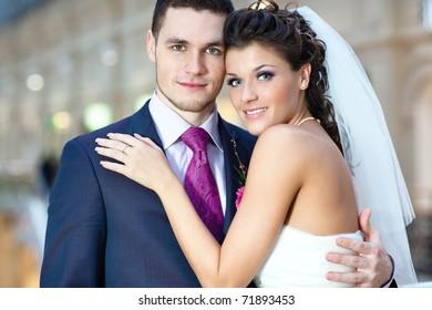 Young wedding couple indoors portrait.
