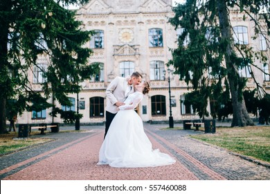 Young wedding couple near the old building