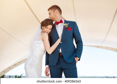Young wedding couple stand face to face with closed eyes and dream of their future life