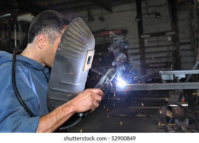 A young welder in the work