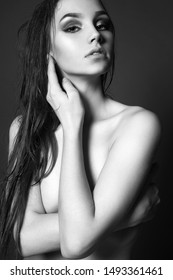 Young wet woman. Naked Beautiful Girl with wet hair. Sensual Nudity