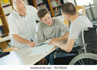 young wheelchair user working on a laptop