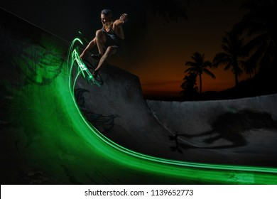 A young white Caucasian skateboarder doing an ollie jump at night