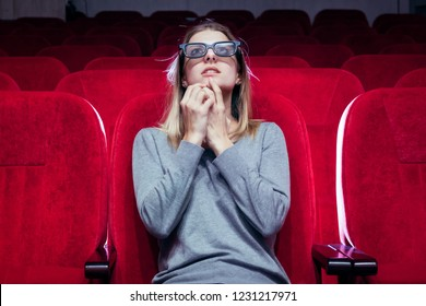 young white europian girl, one came to the movie screening at the cinema, woman watching and very worry for situation