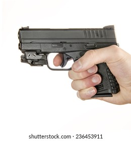 Young white male in his 20s holding a .45 ACP handgun  isolated on white background