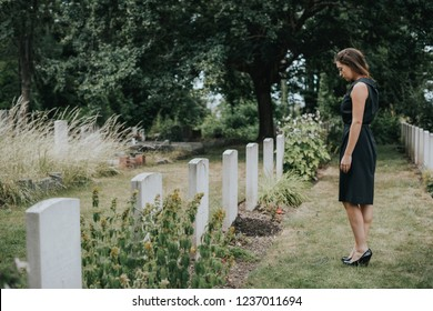 Young widow at a graveyard