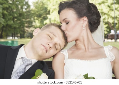 Young wife kissing her husband