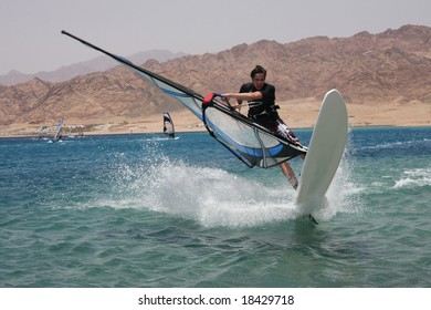 Young windsurfer in Dahab. Egypt, Red Sea.