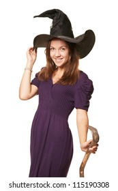 The  young witch with a broom holding a hat