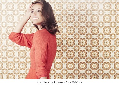Young woman in 1970's fashion looking away