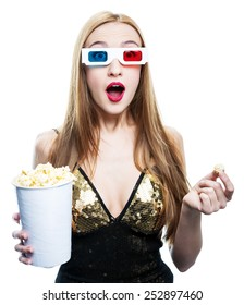 young woman in 3 d glasses and with popcorn in her hands