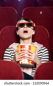 Young woman in 3D glasses watching a movie