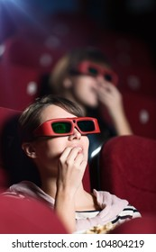 Young woman in 3D movie with popcorn