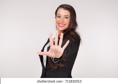young woman with 5 star gesture (focus on hand)