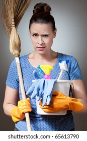 A young woman about to embark on a difficult cleaning job