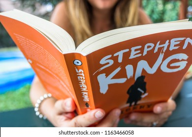 Young  Woman Actor Reads Stephen King Misery Book in Sassello,Italy-August 2018