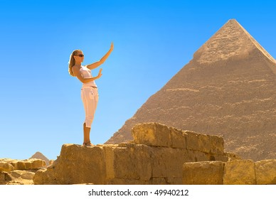 A young woman admires the Egyptian pyramids