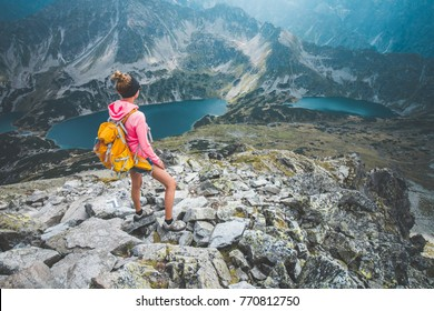 A young woman admiring spectacular views offered by Polish Tatra mountains