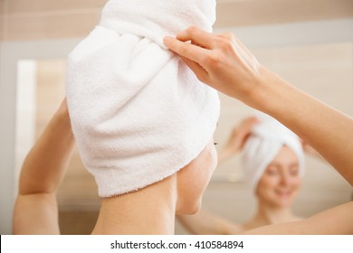 Young woman after morning shower in a bathroom