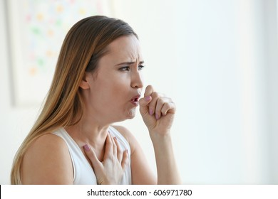 Young woman with allergy at home