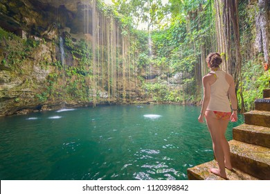 Young woman in amazing Ik-Kil Cenote near Chichen Itza, Mexico