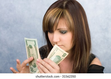Young woman with American dollars