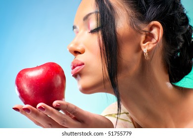Young woman with apple. Rich bright colors.