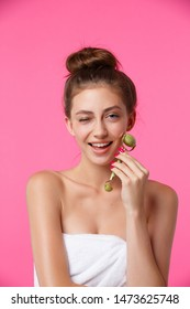 Young woman applying jade roller face massage. Daily facial skincare treatment, anti age procedures for better moisturising, lymphatic drainage, skin tone improve and wrinkles reducing