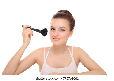 young woman applying powder on the face