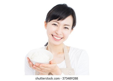 young woman with apron bowl of boiled rice isolated on white background